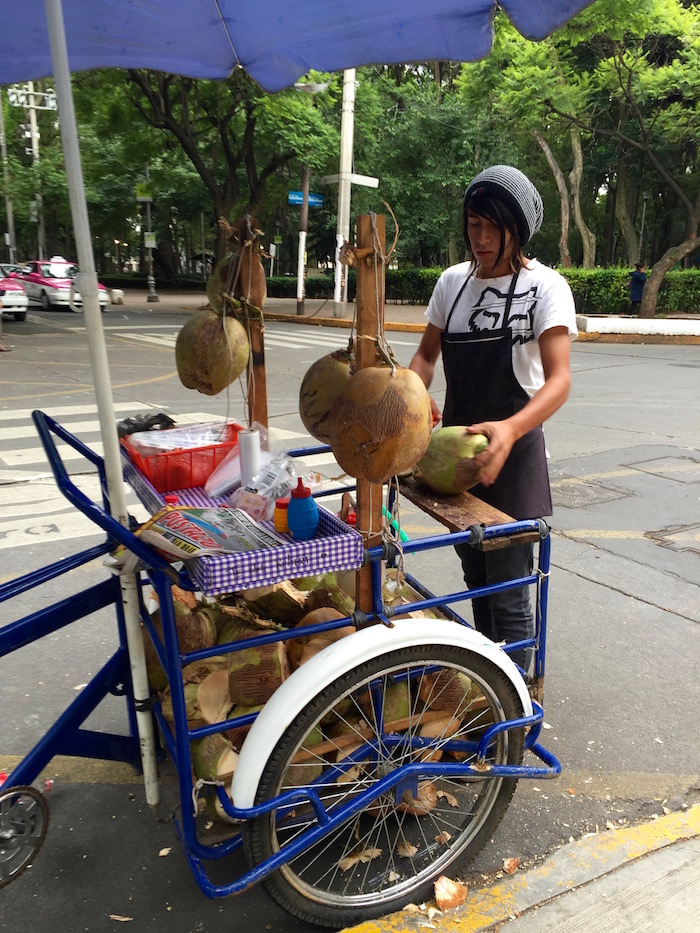 Man preparing fresh coconuts in the center of Mexico city