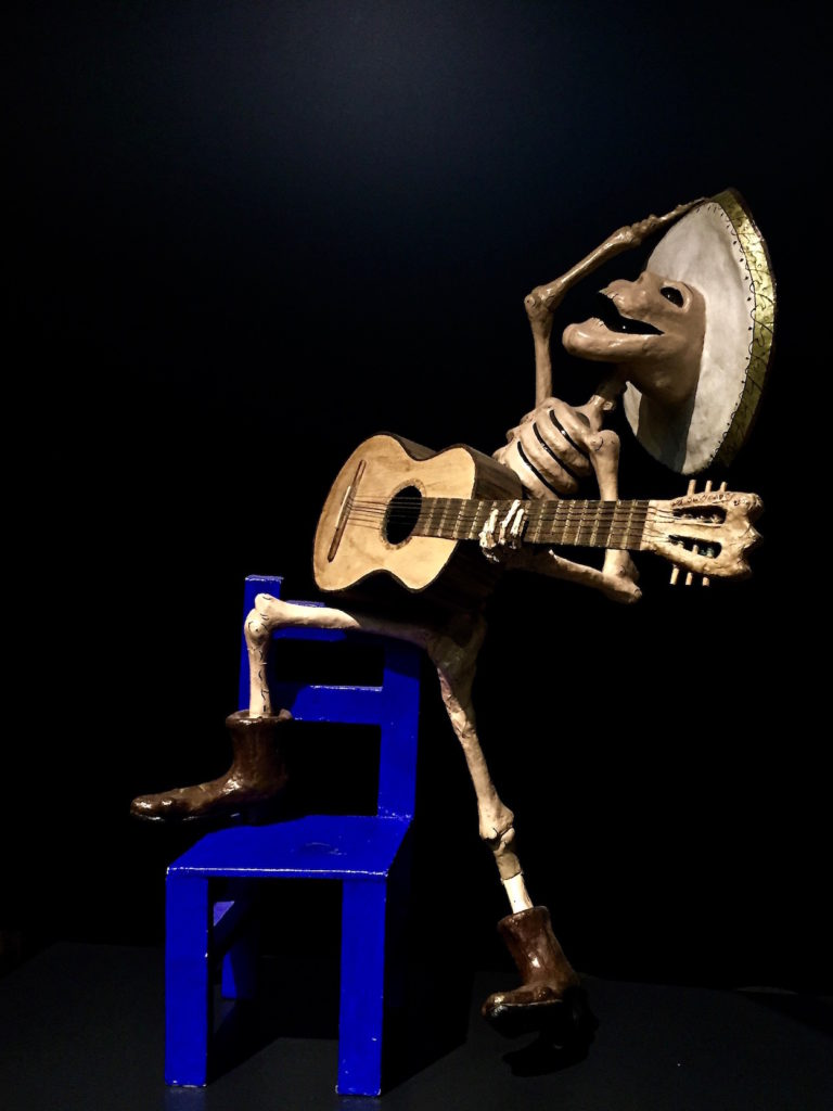 Calaca, a Mexican Skeleton figure of a man playing the guitar, popular art museum, Mexico City