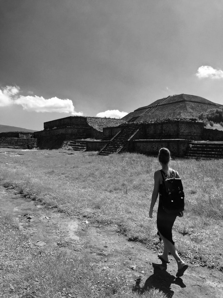 Sophie walking in hard sunlight along the pyramid of the sun, Teotihuacan
