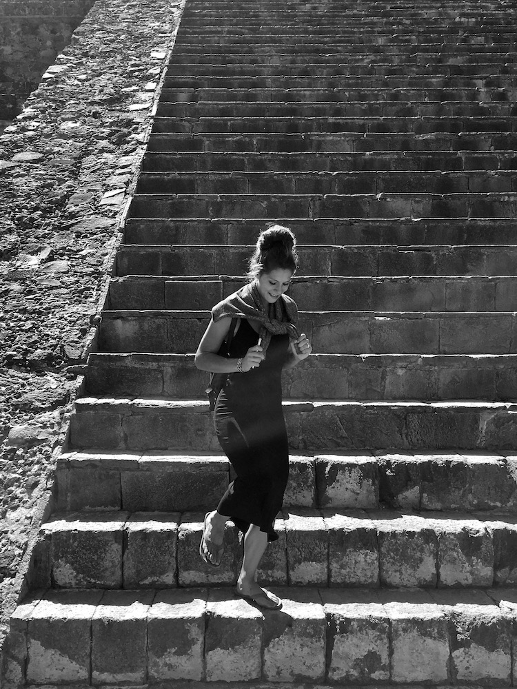Sophie stepping down from the pyramid of the sun at Teotihuacan, Mexico