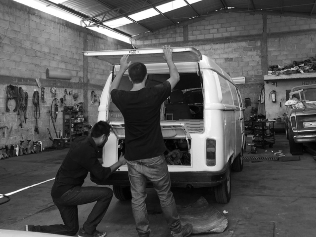 Peter and a Mexican mechanic inspecting a white VW t2 bus