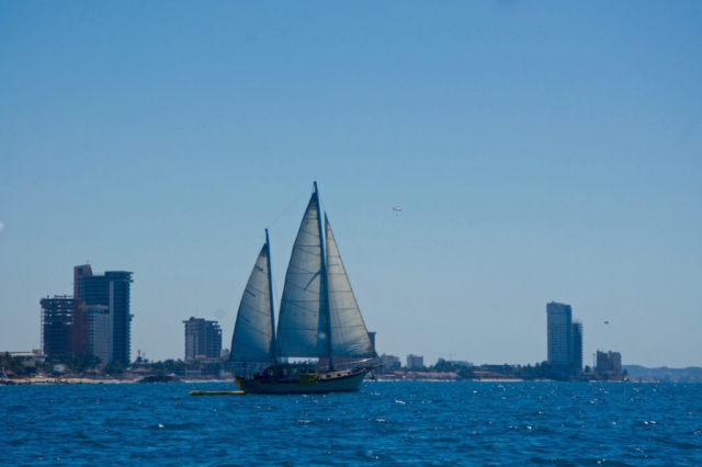 Big sailboat in front of the skyline of Mazatlan as seen from the ocean