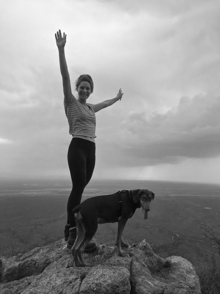 Sophie and Ikarus a young doberman on the top of the mountain