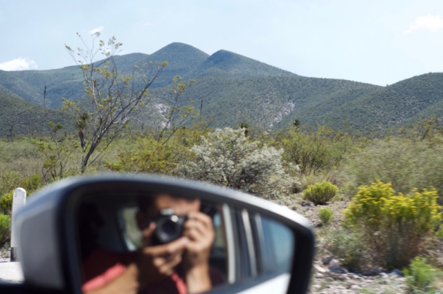 Peter capturing the mountains and himself in the car mirror