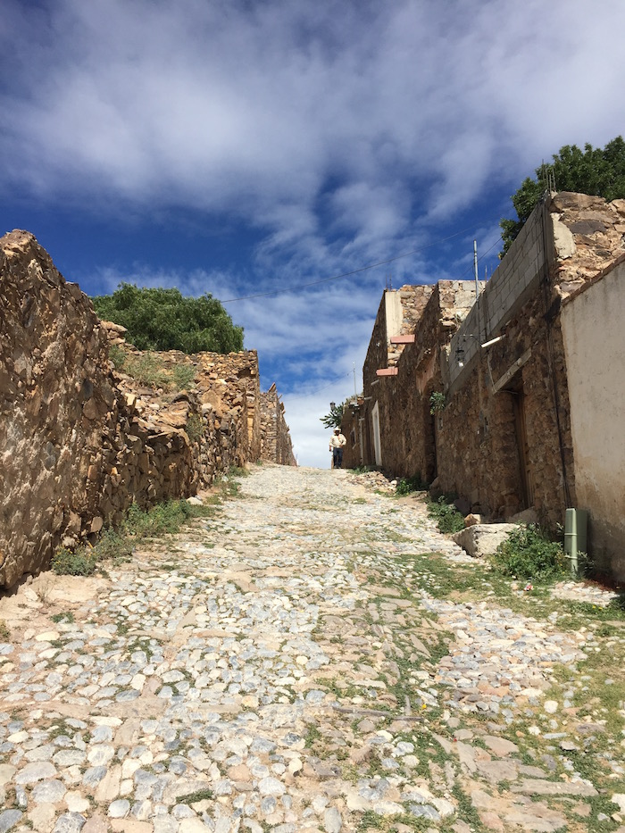 Cobbled pavement and old houses in the desolated village of Real de Catorce in the mountains