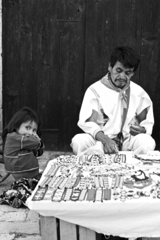 Craftsman in traditional cloth with his little daughter in Real de Catorce, Mexico