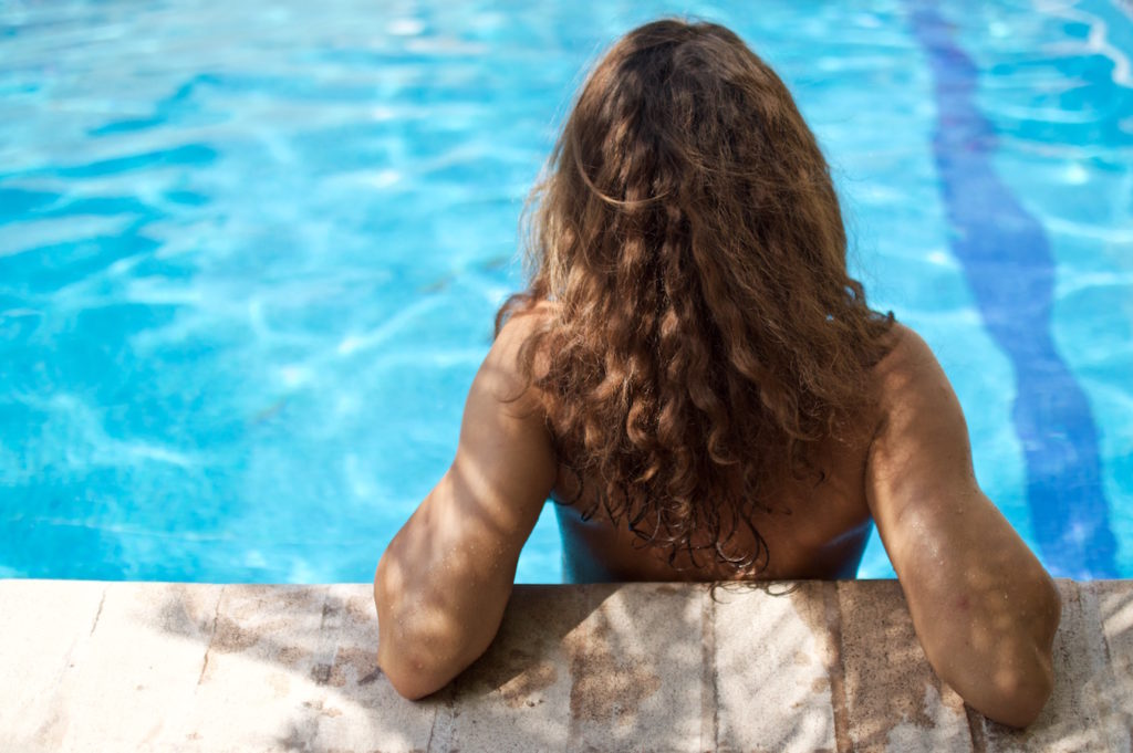 Sophie relaxing topless at the edge of the swimming pool
