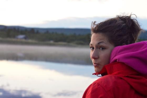 Sophie looking back over her shoulder in the evening in Lapland, Sweden