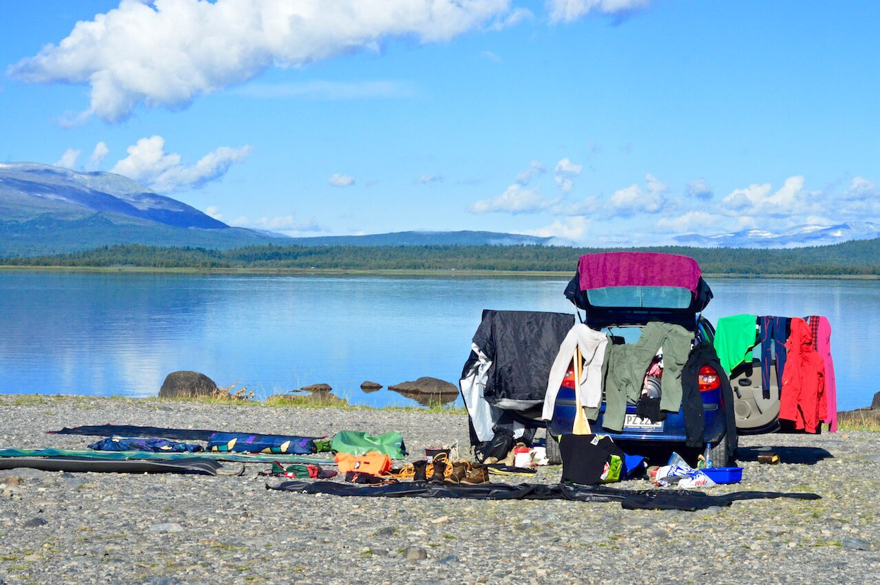 All our equipment spread out around our car to dry out after the canoe tour in Lapland, Sweden