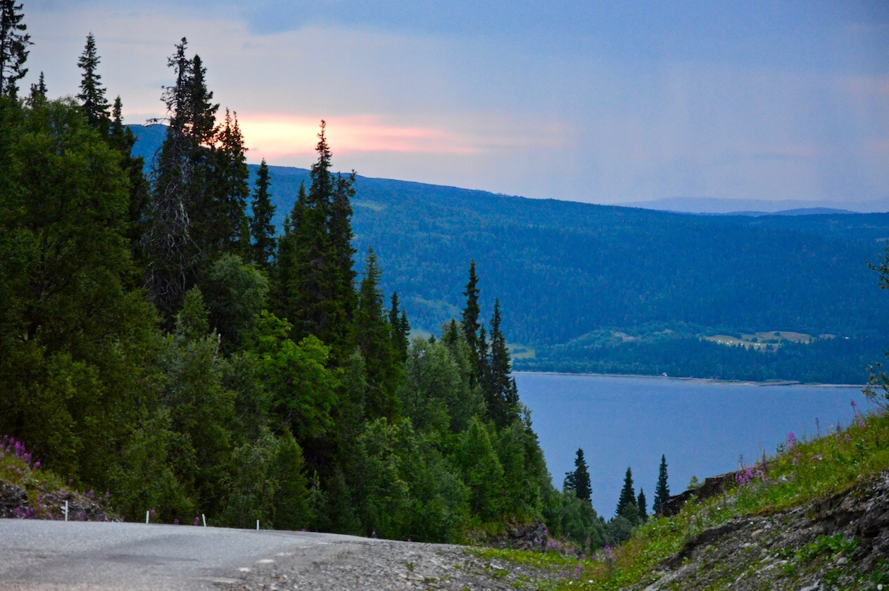 The road between mountains, lakes and forest at sunset in Lapland, Sweden