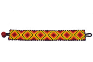 Red, black, yellow Mexican bracelet as seen from above