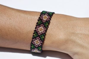 Mexican bracelet with waterlilies on a woman's wrist