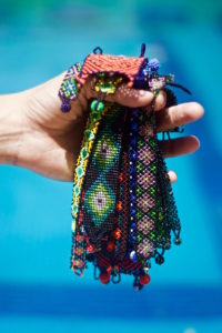 a bunch of Mexican bracelets in the hand