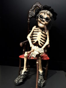 Calaca - mexican skeleton figure - of an old lady in her chair reminding us of that old man who worked in the office for that touristic permit to travel Mexico
