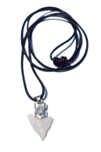 A pendant with a granite arrowhead lined in silver on a leather cord with a glittering opal jewel in the center