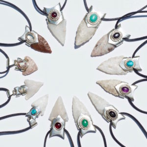 a collection of handmade necklaces made of silver and rare jewels