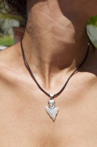 Opal necklace around the neck of a girl