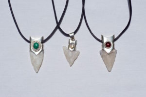 Handmade Necklaces out of silver with a garnet an opal and malachite