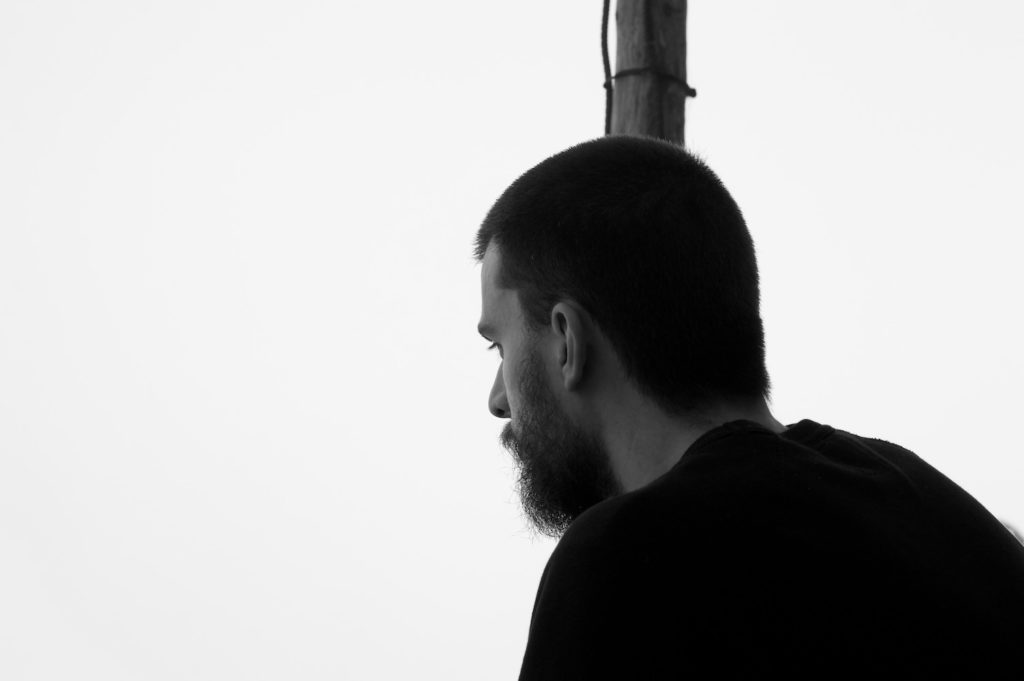 Peter looking into the fog captured in black and white