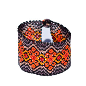 Handmade Mexican bracelet with an ancient pattern in the colors orange and dark grey made out of glas pearls