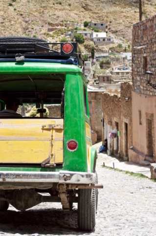 Old green Jeep in the streets of an old Mexican village