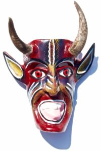 Wooden devils mask hand carved out of wood and with real goat horns