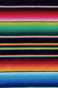 Black Mexican blanket with very strong blue orange, red, green, yellow and pink stripes